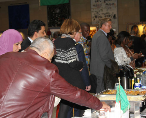The guests being teased the Algerian National food - CousCous.